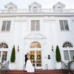 Bride and Groom on the front steps of Duke Mansion