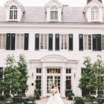 A bride standing in front of Duke Mansion