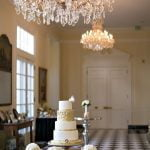 A wedding cake and a chandelier