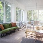 Screened-in Porch with sitting chairs.