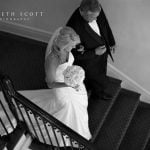 A bride descends the stairwell at Duke Mansion