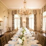 Social Dining Room with white and blue accents and a hanging chandelier