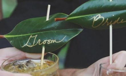 Leaves with Bride & Groom written in gold on them.